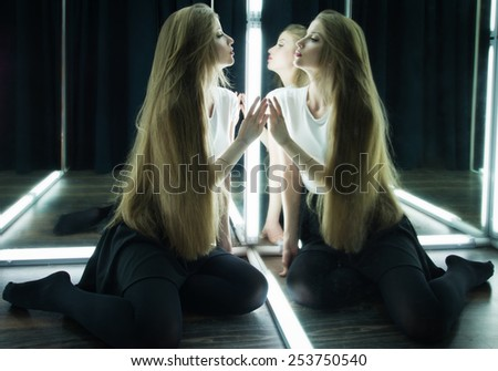 beautiful sexy girl and her reflection in mirror table - stock photo