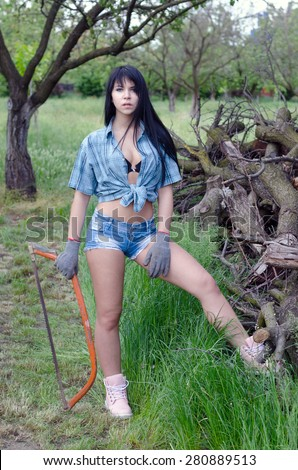 stock photo beautiful sexy girl cutting wood in orchard in spring 280889513
