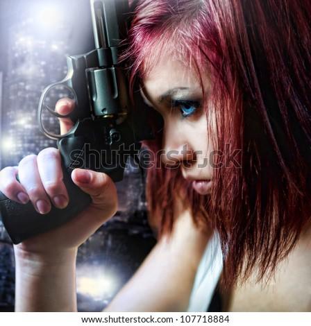 beautiful sexy girl holding gun - stock photo