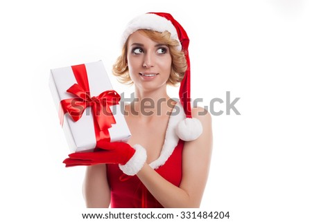 Beautiful sexy girl holds Santa Claus gift  on a white background
