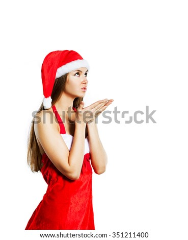 Beautiful sexy girl in a Christmas suit, isolated on a white background.