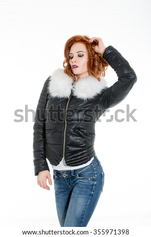 beautiful sexy girl in a fashionable fur coat