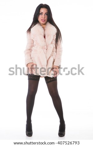 beautiful sexy girl in a fur coat, isolated on white