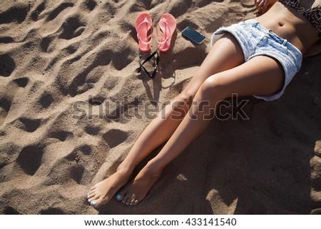 beautiful sexy girl lying on the beach  - stock photo