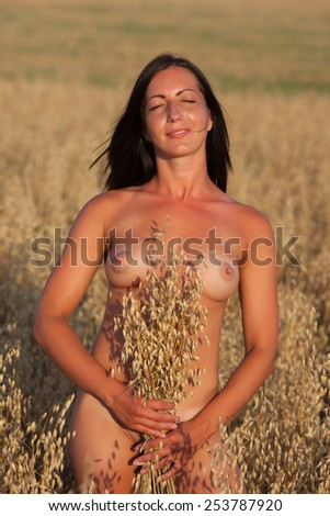 Beautiful sexy girl on floral field - stock photo