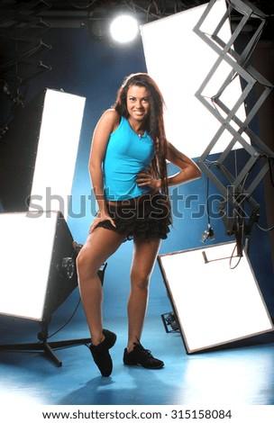 beautiful sexy girl on studio equipment . long beautiful hair. vivid emotions - stock photo