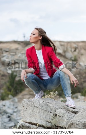 Beautiful sexy girl posing at stone
