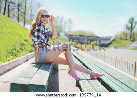 Beautiful sexy girl stylish hipster posing in summer - stock photo