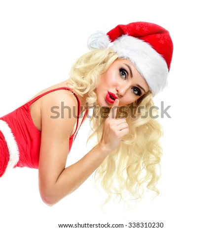 Beautiful sexy girl wearing santa claus clothes. Christmas Woman. Beauty Model Girl in Santa Hat isolated on White Background. - stock photo