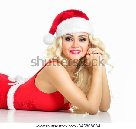Beautiful sexy girl wearing santa claus clothes. Christmas Woman. Beauty Model Girl in Santa Hat isolated on White Background.