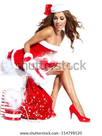 beautiful sexy girl wearing santa claus clothes with christmas gift - stock photo