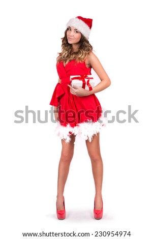 beautiful sexy girl wearing santa claus clothes with present isolated on white background - stock photo