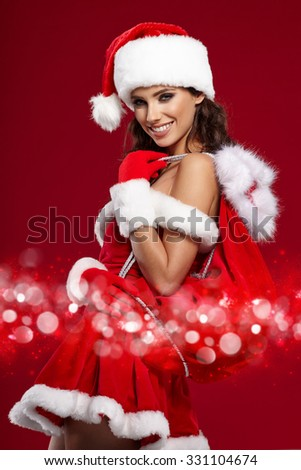 beautiful sexy girl wearing santa claus costume - stock photo
