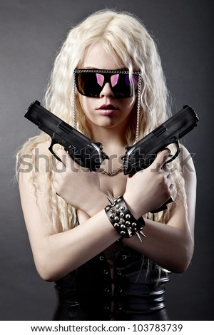 Beautiful sexy girl with guns isolated on black background