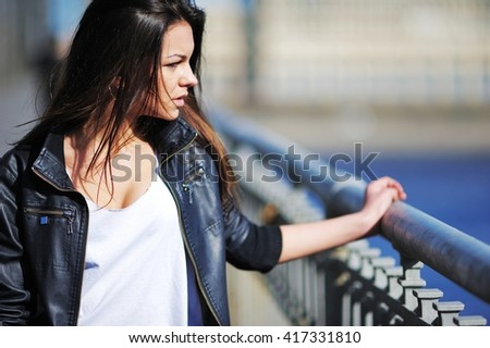 beautiful sexy girl with long hair standing and romantically looks. Her hair fluttering in the wind. - stock photo