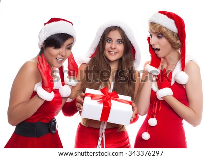 beautiful sexy girls wearing santa claus clothes with present box
