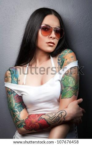 Beautiful sexy glamorous girl with tattoos.tattoo - stock photo