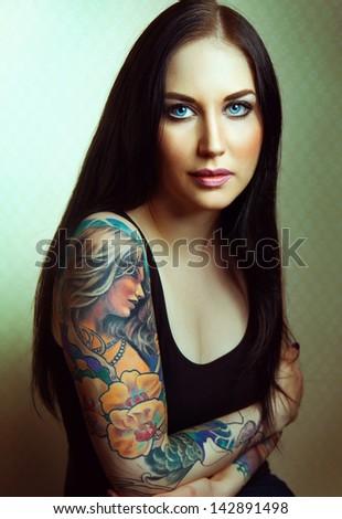 Beautiful sexy glamorous girl with tattoos. tattoo - stock photo