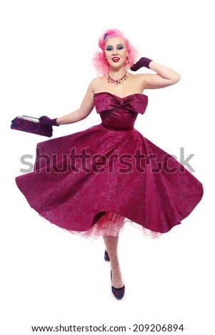Beautiful sexy happy pink-haired girl in gorgeous vintage dress over white background - stock photo