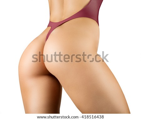 Beautiful sexy lady in elegant black bodysuit. Portrait of fashion model girl indoors. Beauty woman with attractive buttocks - stock photo