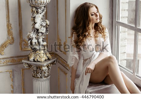 Beautiful sexy lady in elegant white robe. Close up fashion portrait of model indoors. Beauty blonde woman with attractive body in lace lingerie. Female ass in underwear. Closeup naked girl - stock photo