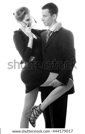 Beautiful sexy lady seducing young businessman isolated on white in black and white colors.