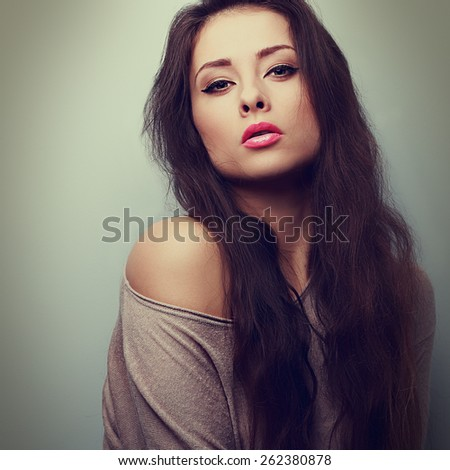 Beautiful sexy makeup woman with long hair in sweater. Vintage closeup portrait - stock photo