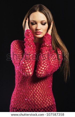 Beautiful sexy model in pink crocheted clothing - stock photo