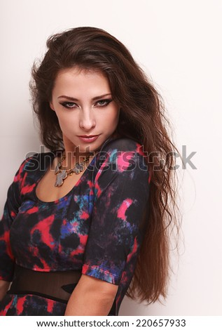 Beautiful sexy model with long hair posing in fashion necklace