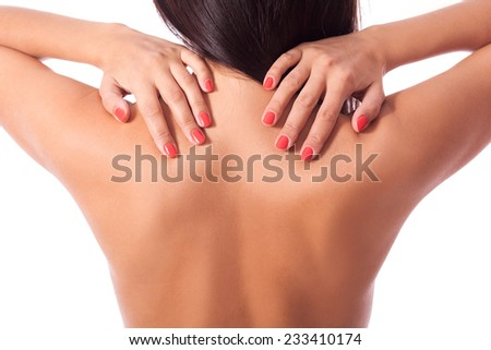 beautiful sexy naked woman girl sun-tanned body,holding back with hands, back pain ache, isolated  - stock photo