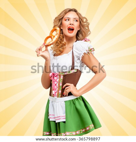 Beautiful sexy Oktoberfest woman wearing a traditional Bavarian dress dirndl with open mouth eating a pretzel on colorful abstract cartoon style background.