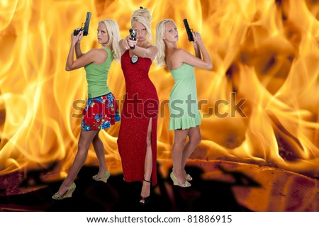 Beautiful sexy police women detectives standing in front of a blazing fire
