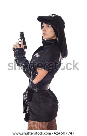 Beautiful sexy policewoman with handcuffs in a black uniform that aiming a gun. Isolated on white.