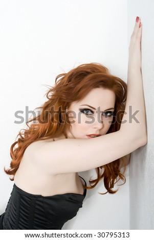 Beautiful sexy redhead young woman - stock photo