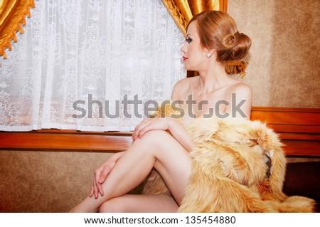 Beautiful sexy retro girl in  wagon train - stock photo