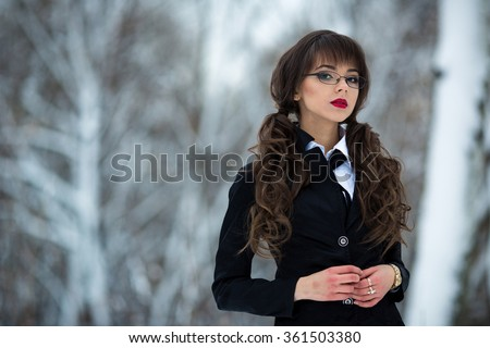 Beautiful,sexy,sexual,smart,cute,young teacher,student,teacher,schoolgirl,girl,woman cool suit checkered,short skirt,wearing spectacles,looks proud forward,self-confident.Secretary,model,work,manager. - stock photo