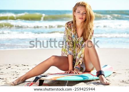 Beautiful sexy surfer girl on the beach  - stock photo