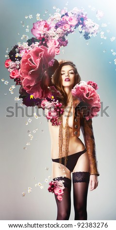 beautiful sexy woman and big flowers - stock photo
