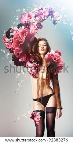 beautiful sexy woman and big flowers - stock photo