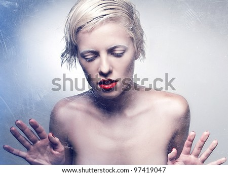 Beautiful Sexy Woman Behind Glass - stock photo
