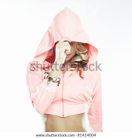 Beautiful sexy woman in a hood on white background