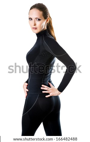 Beautiful sexy woman in black hot sports thermolinen underwear for downhill skiing isolated on white background - stock photo