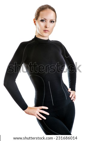 Beautiful sexy woman in black hot sports thermolinen underwear for downhill skiing isolated on white background. T-shirt with long sleeves and leggings - stock photo