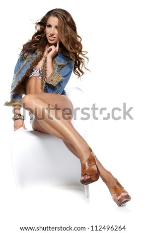 Beautiful sexy woman in blue jeans - stock photo