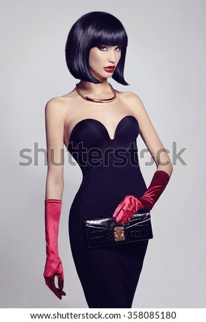 beautiful sexy woman in elegant black dress, gloves and clutch.retro bob hairstyle beauty girl - stock photo