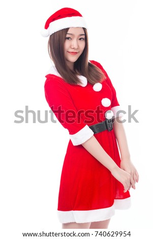 Beautiful sexy woman in red christmas dress standing isolated over white background