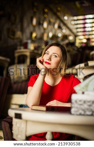 Beautiful sexy woman in restaurant cafe - stock photo