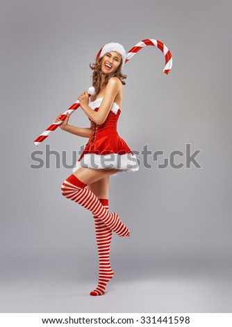 Beautiful sexy woman in Santa Claus clothes - stock photo
