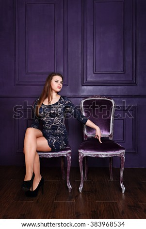 Beautiful sexy woman inviting to sit on a chair - stock photo