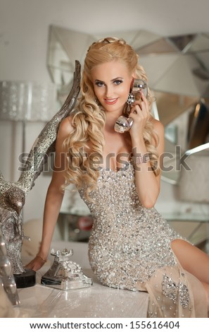Beautiful sexy woman pinup style talking on phone at luxury interior ...: http://www.shutterstock.com/cat.mhtml?models=14148029&models=14319137&context_photo=155609666